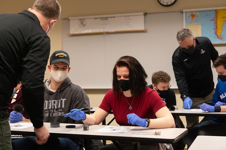 Criminal justice students rolling fingerprints